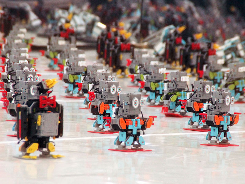 Over 100 mini robots dancing in Times Square