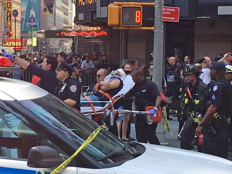 Car plows into pedestrians in Times Square